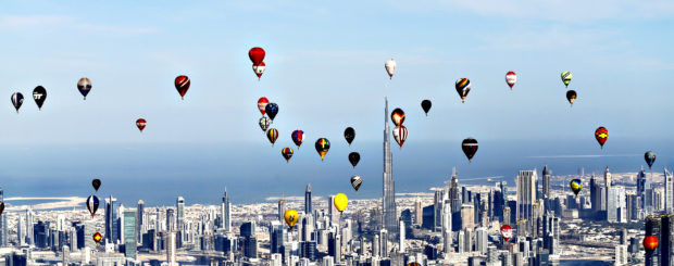 Hot air balloons fly over Dubai during the World Air Games 2015,